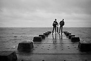Boys on a pier, UK, 1980s