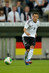 06.09.2013, Allianz Arena, Muenchen, GER, FIFA WM Qualifikation, Deutschland vs Oesterreich, Rueckspiel, im Bild Mesut Oezil (GER) am Ball Freisteller, Einzelbild, Aktion vor Deutschlandflagge Flagge,, , Qualifikation Weltmeisterschaft Brasilien 2014 Rueckspiel , Saison 2013 2014 Muenchen Allianz-Arena, 06.09.2013 // during the FIFA World Cup Qualifier second leg Match between Germany and Austria at the Allianz Arena, Munich, Germany on 2013/09/06. EXPA Pictures © 2013, PhotoCredit: EXPA/ Eibner/ Michael Weber<br /> <br /> ***** ATTENTION - OUT OF GER *****