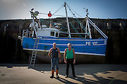 Reg &amp; Ray Brickell<br /> <br /> Viking Princess - FE137 <br /> <br /> 3rd Generation Fishermen<br /> <br /> Main Activities: Trawling, Scalloping, Netting &amp; Channel Swims<br /> Folkestone was founded on its fishing industry which dates back to pre-Roman times.  During its heyday there were over 100 boats operating out of the busy harbour and employing over 1000 people in the town.  However today, there are only 8 working boats left, employing just over 20 people. The boats are owned and managed by Folkestone families who have a strong fishing heritage. Photographer Andrew Aitchison, has been working with Folkestone Trawlers to capture portraits of the active fishermen in the summer of 2016.