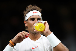 Rafael Nadal drinks during his match against Novak Djokovic on day eleven of the Wimbledon Championships at the All England Lawn Tennis and Croquet Club, Wimbledon. PRESS ASSOCIATION Photo. Picture date: Saturday July 14, 2018. See PA story TENNIS Wimbledon. Photo credit should read: Daniel Leal-Olivas/PA Wire. RESTRICTIONS: Editorial use only. No commercial use without prior written consent of the AELTC. Still image use only - no moving images to emulate broadcast. No superimposing or removal of sponsor/ad logos. Call +44 (0)1158 447447 for further information.