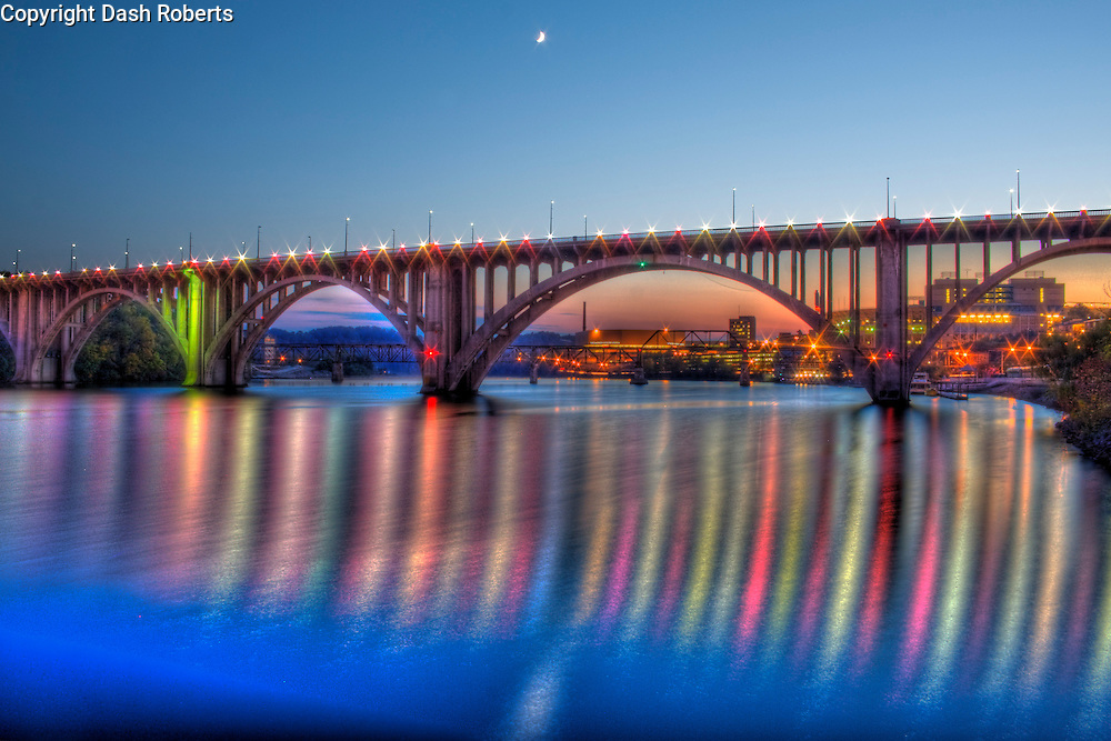 The moon rises over the Henley Street Bridge as night falls on downtown Knoxville, Tennessee.