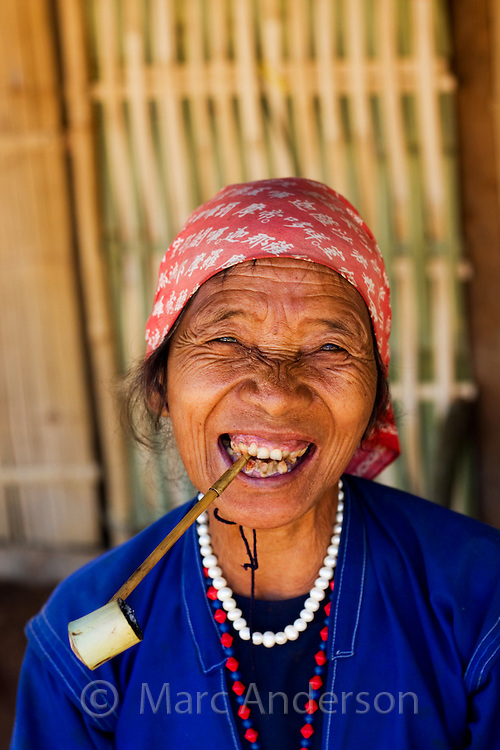 Old Thai woman smoking a pipe, Tha Ton, Chiang Mai Province, Thailand
