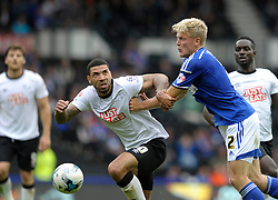 Derby County's Leon Best jostles for the ball with Ipswich Town's Jonathan Parr - Photo mandatory by-line: Dougie Allward/JMP - Mobile: 07966 386802 30/08/2014 - SPORT - FOOTBALL - Derby - iPro Stadium - Derby County v Ipswich Town - Sky Bet Championship