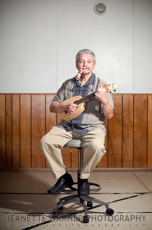 People pose with their ukulele for a portrait session in Austin, Texas.<br /> <br /> Walter Minkel plays his ukulele &quot;The Monkey&quot; and his handmade kazoo.  Both instruments are made from birds eye maple.
