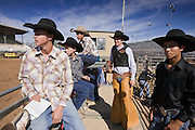 November 2, 2008 -- PHOENIX, AZ: Competitors watch one of their colleagues ride at the Arizona High School Rodeo at the Arizona State Fair in Phoenix. Teams from across the state participate. The Arizona High School Rodeo Association sponsors a full season of high school rodeo that culminate in a championship rodeo in June.  Photo by Jack Kurtz / ZUMA Press