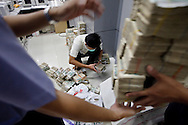 (November 22, 2012 Yangon, Myanmar).Clerks count bundles of money at C B Bank in Yangon, Myanmar in on Nov 22, 2012 Myanmar's economy is predicted to grow by over 6.0% next year on the back of commodity exports and a pick-up in foreign investment..(Photo by Kuni Takahashi)