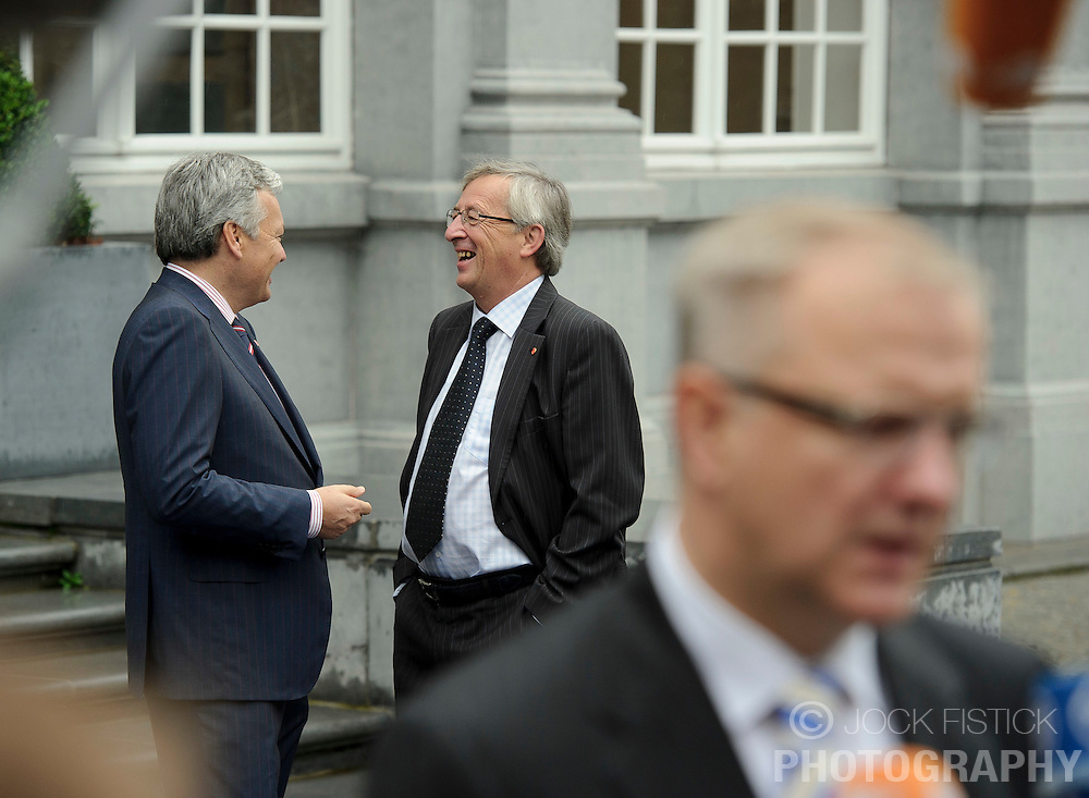 Jean-Claude Juncker, Luxembourg's prime minister, and president of the Eurogroup, center, speaks with Didier Reynders, Belgium's finance minister, left, as Olli Rehn, The EU's economic and monetary affairs commissioner, right, speaks to the press as they arrive for the Eurogroup meeting in Brussels, Thursday Sept. 30, 2010. (Photo © Jock Fistick)
