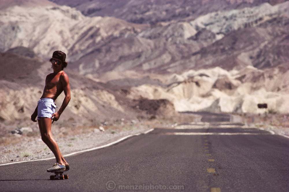 Death Valley. Skateboarding in July from Zabriskie Point to Badwater. MODEL RELEASED.