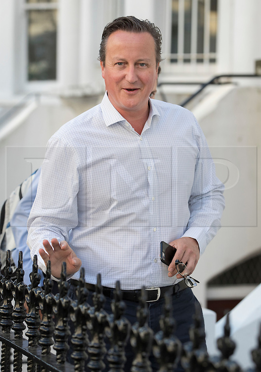 © Licensed to London News Pictures. 14/09/2016. London, UK. Former Prime Minister David Cameron arrives home.  Mr Cameron has been criticised in a new Parliamentary report into Britain's involvement in Libya and the overthrow of Libyan leader Muammar Gaddafi in 2011. The foreign affairs committee accused Mr Cameron of lacking a coherent strategy for the air campaign.Photo credit: Peter Macdiarmid/LNP