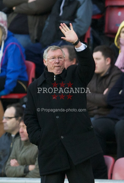 WIGAN, ENGLAND - Saturday, February 26, 2011: Manchester United's manager Alex Ferguson celebrates during his side's 4-0 Premiership victory over Wigan Athletic at the DW Stadium. (Photo by David Rawcliffe/Propaganda)