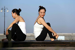 July 18, 2018 - Wuhu, Wuhu, China - Wuhu, CHINA-Women practice yoga by Yangtze River in Wuhu, east China's Anhui Province. (Credit Image: © SIPA Asia via ZUMA Wire)