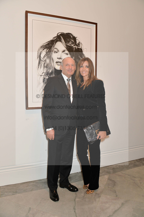 RON DENNIS and CAROL WEATHERALL at a private view of photographs by David Bailey entitled 'Bailey's Stardust' at the National Portrait Gallery, St.Martin's Place, London on 3rd February 2014.