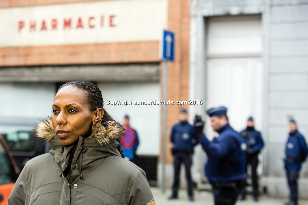 20160319 story on the streets and people of Molenbeek, after Salam Abdeslam was arrested a day before. The house in the four winds street where Abdeslam was captured in the background, next to the pharmacie in the four winds street where Abdeslam was captured with an American journalist ready to go live.