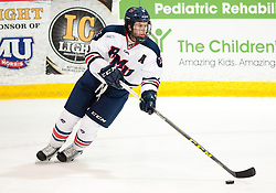 March 13 2016: Robert Morris Colonials defenseman Evan Moore (5) skates with the puck during the second period in game three of the Atlantic Hockey quarterfinals series between the Bentley Falcons and the Robert Morris Colonials at the 84 Lumber Arena in Neville Island, Pennsylvania (Photo by Justin Berl)
