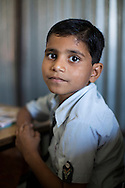 Ankit Bamaniya, aged 5, studies English in class in the Vasudha Vidya Vihar school in Khargone, Madhya Pradesh, India on 12 November 2014. The son of a cotton farmer, Ankit wants to be a Doctor when he grows up, so that he can help everyone in need. Photo by Suzanne Lee for Fairtrade