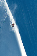 Extreme skiing down a cornice.