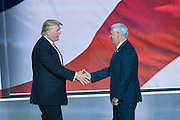 GOP Presidential nominee Donald Trump congratulates his running mate Gov. Mike Pence after Pence formally accepted the nomination during the third day of the Republican National Convention July 20, 2016 in Cleveland, Ohio.