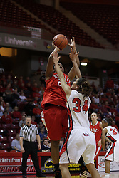 30 December 2010: Latasha Hollingshed takes a shot over defender Hannah Spanich during an NCAA Womens basketball game between the Bradley Braves and the Illinois State Redbirds at Redbird Arena in Normal Illinois.