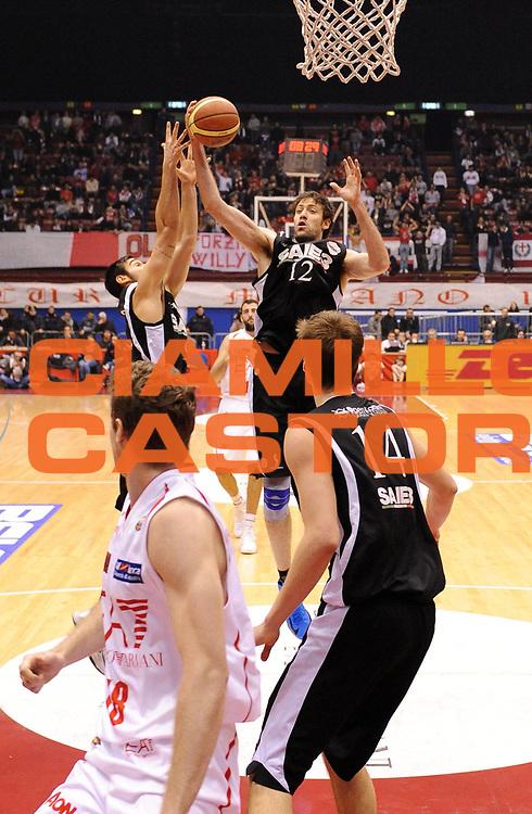 DESCRIZIONE : Milano Lega A 2012-13 EA7 Olimpia Armani Milano Saie3 Bologna<br /> GIOCATORE : Angelo Gigli<br /> SQUADRA : Saie3 Bologna<br /> EVENTO : Campionato Lega A 2012-2013<br /> GARA :  EA7 Olimpia Armani Milano Saie3 Bologna<br /> DATA : 27/01/2013<br /> CATEGORIA : Rimbalzo<br /> SPORT : Pallacanestro<br /> AUTORE : Agenzia Ciamillo-Castoria/A.Giberti<br /> Galleria : Lega Basket A 2012-2013<br /> Fotonotizia : Milano Lega A 2012-13 EA7 Olimpia Armani Milano Saie3 Bologna<br /> Predefinita :
