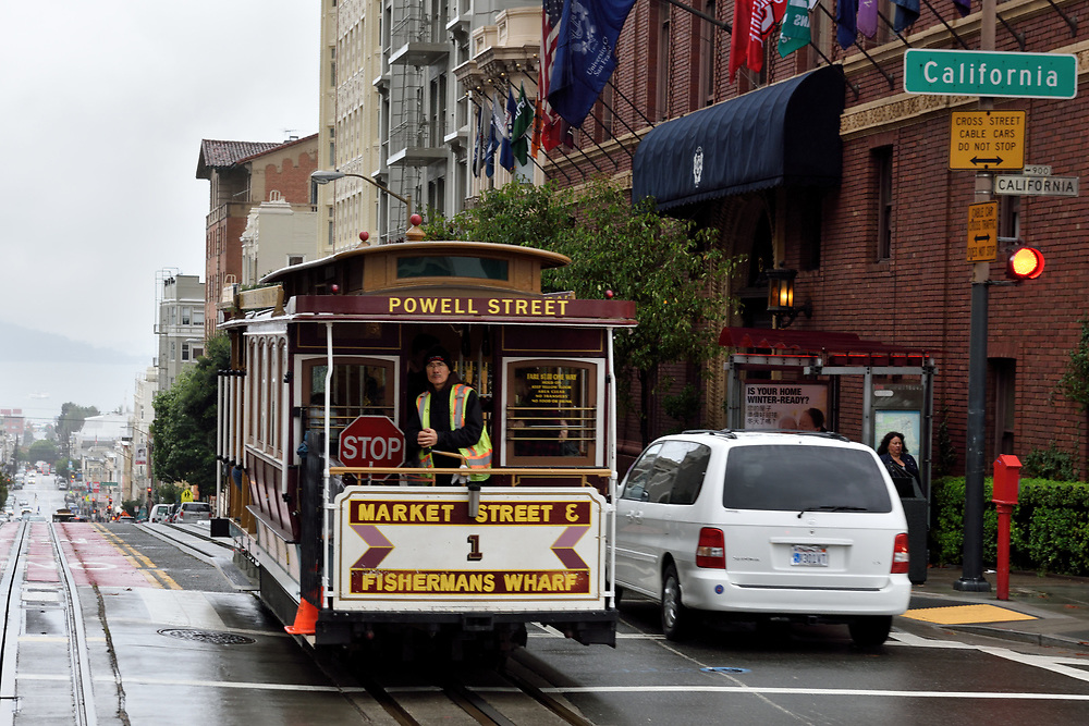 A cable car on a rainy winter day in San Francisco, California on November 16'th, 2017.  San Francisco's Municipal Railway has assembled one of the most diverse collections of vintage streetcars, trolleys, and trams in transit service.Photo by Gili Yaari