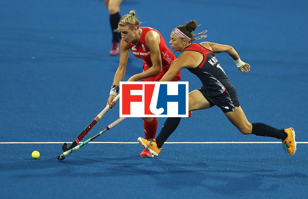 RIO DE JANEIRO, BRAZIL - AUGUST 13:  Lily Owsley (L) of Great Britain is tackled by Michelle Kasold during the Women's group B hockey match between Great Britain and the USA on Day 8 of the Rio 2016 Olympic Games at the Olympic Hockey Centre on August 13, 2016 in Rio de Janeiro, Brazil.  (Photo by David Rogers/Getty Images)