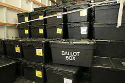 © Licensed to London News Pictures. 06/05/2015. Sheldon, Birmingham, UK. Election ballot boxes being delivered to Sheldon Community Centre, near Birmingham. The ballot boxes have been in archival storage since the last election, they are now delivered to designated distribution centres, from where they will be collected by polling stations in the area in readiness for when the polling stations open. Hundreds of ballot boxes will be in use in Birmingham during the election count. At the close of the election count they will once again be put back into storage. Photo credit : Dave Warren/LNP