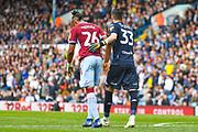 Francisco Casilla of Leeds United (33) checks on injured Jonathan Kodjia of Aston Villa (26) during the EFL Sky Bet Championship match between Leeds United and Aston Villa at Elland Road, Leeds, England on 28 April 2019.