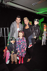 NICOLA McLEAN and TOMMY WILLIAMS and their son ROCKY and ? & ? at the premier of Ben Ten Alien Force at the Old Billingsgate Market, City of London on 15th February 2009.