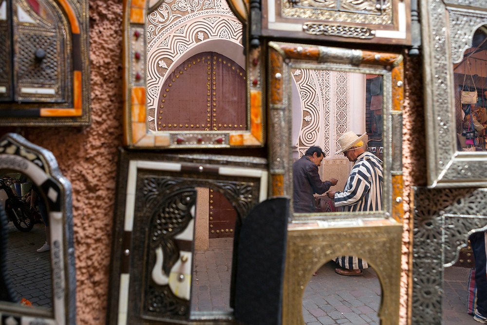 MARRAKESH, MOROCCO - May 27th 2018 - Mirrors hanging on the wall in Marrakech Medina, Morocco