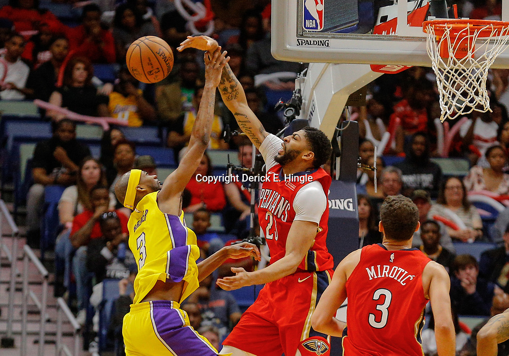 Feb 14, 2018; New Orleans, LA, USA; New Orleans Pelicans forward Anthony Davis (23) blocks a shot by Los Angeles Lakers forward Corey Brewer (3) during the second half at the Smoothie King Center. The Pelicans defeated the Lakers 139-117. Mandatory Credit: Derick E. Hingle-USA TODAY Sports