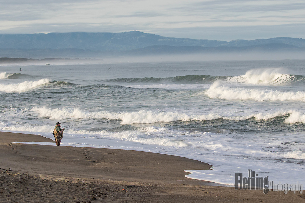 A surf fisherman tries his luck in the Pacific Ocean near Santa Cruz, California