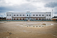 """Facciata dell'ex centro di permanenza temporanea """"Casa Regina Pacis"""" a San foca (LE) ormai in disuso. 21/02/2010 (PH Gabriele Spedicato)..I Centri di permanenza temporanea (CPT), ora denominati Centri di identificazione ed espulsione (CIE), sono strutture istituite in ottemperanza a quanto disposto all'articolo 12 della legge Turco-Napolitano (L. 40/1998) per ospitare gli stranieri """"sottoposti a provvedimenti di espulsione e o di respingimento con accompagnamento coattivo alla frontiera"""" nel caso in cui il provvedimento non sia immediatamenti eseguibile."""