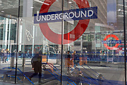 Commuters and the London Underground roundels outside the newest entrance to Victoria underground station, on 11th March 2019, in London, England.