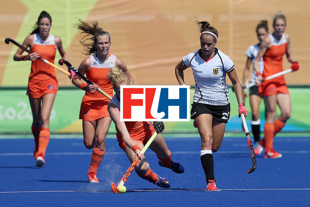 RIO DE JANEIRO, BRAZIL - AUGUST 17: Margot van Geffen #23 of Netherlands and Pia-Sophie Oldhafer #29 of Germany go after the ball during the women's semifinal match between the Netherlands and Germany on Day 12 of the Rio 2016 Olympic Games at the Olympic Hockey Centre on August 17, 2016 in Rio de Janeiro, Brazil.  (Photo by Rob Carr/Getty Images)