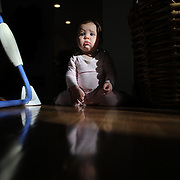An eight month old baby girl at play.  Photo Tim Clayton