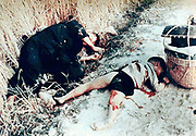 Unidentified Vietnamese man and child killed by US soldiers Source Report of Army review into My Lai incident, book 6, 14 March 1970.