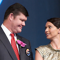 MACAU, CHINA - JUNE 01:  Businessman James Packer and wife Erica Baxter looks each other during the opening of Packer and Lawrence Ho's 'City of Dreams' casino on June 1, 2009 in Cotai, Macau. The new 420,000 square foot casino, built on marshland 9km from Macao's traditional casino district but over the road from the world's largest casino 'Sands Venetian Macao', hopes to lure customers to the new casino area. 'City of Dreams' will offer over 500 gambling tables alongside its 3 hotels, a shopping mall and digital fish which swim in an electronic aquarium know as 'The Bubble'.  Photo by Victor Fraile / studioEAST