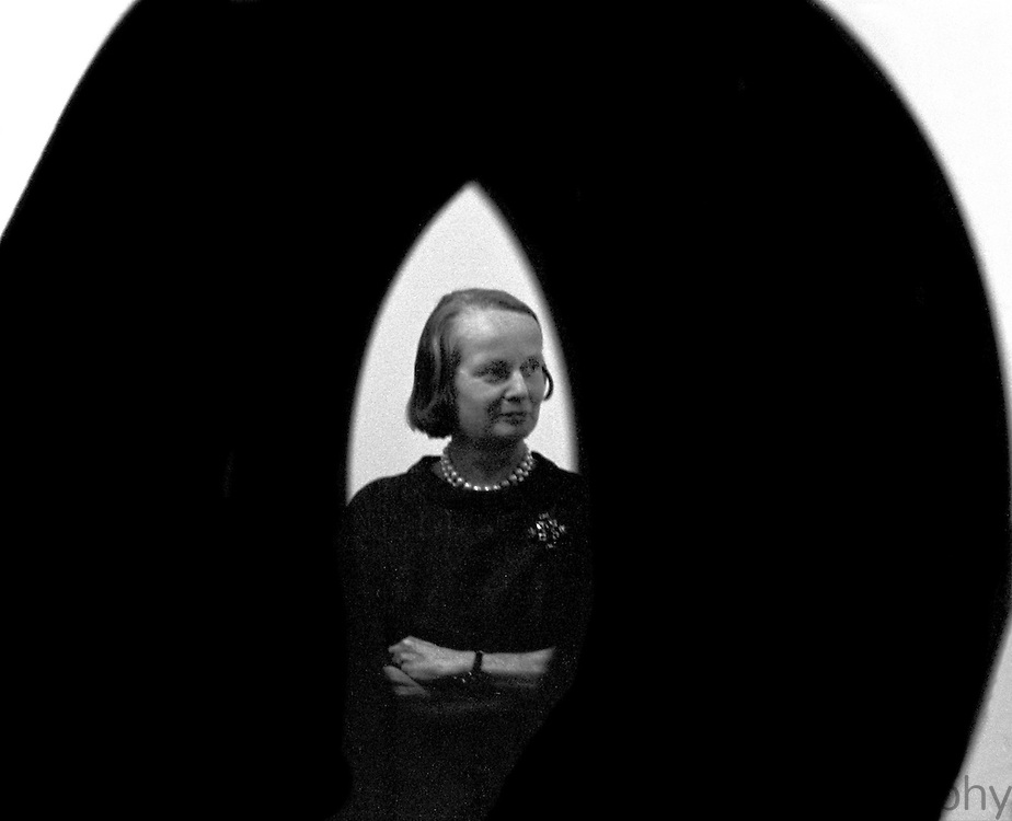 "Parsons framed by Alexander Liberman sculpture. Published in ""Betty Parsons"" by Lee Hall, 1991. Taken in 1963 with a 35 mm Nikon F."