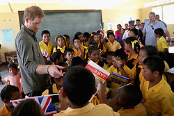 Prince Harry meets young children as he visits Fairview village in the Hinterland on day 13 of an official visit to the Caribbean in Sumara, Guyana.