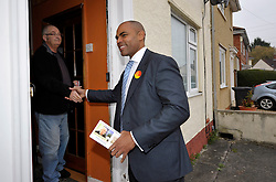 © Licensed to London News Pictures. 15/11/2012. Bristol, UK. Marvin Rees, the Labour candidate and favourite to win the first election for Mayor of Bristol, canvasses for votes in the Lockleaze area of the city.  There are 15 candidates for the mayor, and 4 candidates for the Police and Crime Commissioner for Avon & Somerset Police.  15 November 2012..Photo credit : Simon Chapman/LNP