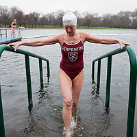 LONDON, ENGLAND - DECEMBER 25:  A member of the Serpentine Swimming Club exits the icy Serpentine waters during the annual Christmas Day Peter Pan Cup on December 25, 2009 in London, England.  The traditional 100 yards Christmas race got its name in 1904 after Sir James Barrie presented the first Peter Pan Cup and is only open to club members who have competed in at least three of the winter series races.   (Photo by Marco Secchi/Getty Images)