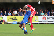 AFC Wimbledon striker Kweshi Appiah (9) getting fouled during the EFL Sky Bet League 1 match between AFC Wimbledon and Scunthorpe United at the Cherry Red Records Stadium, Kingston, England on 15 September 2018.