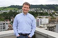 Vitus Ammann, CMO of Monetas, on the top of the buliding where the company has its office in Zug, Switzerland / Vitus Ammann, directeur marketing de Monetas, sur le toit du bâtiment où sont les bureaux de Monetas, Zoug, Suisse