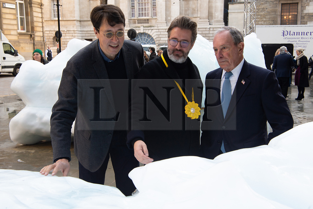 © Licensed to London News Pictures. 11/12/2018. London, UK. Minik Rosing<br /> Professor of Geology at the<br /> Natural History Museum of Denmark at Copenhagen University; Artist Olafur Eliasson and Michael R. Bloomberg UN Special Envoy for Climate Action and Founder of Bloomberg LP and Bloomberg Philanthropies launch Ice Watch display blocks of melting glacier ice across two public sites in the centre of London to create a major artwork. Photo credit: Ray Tang/LNP