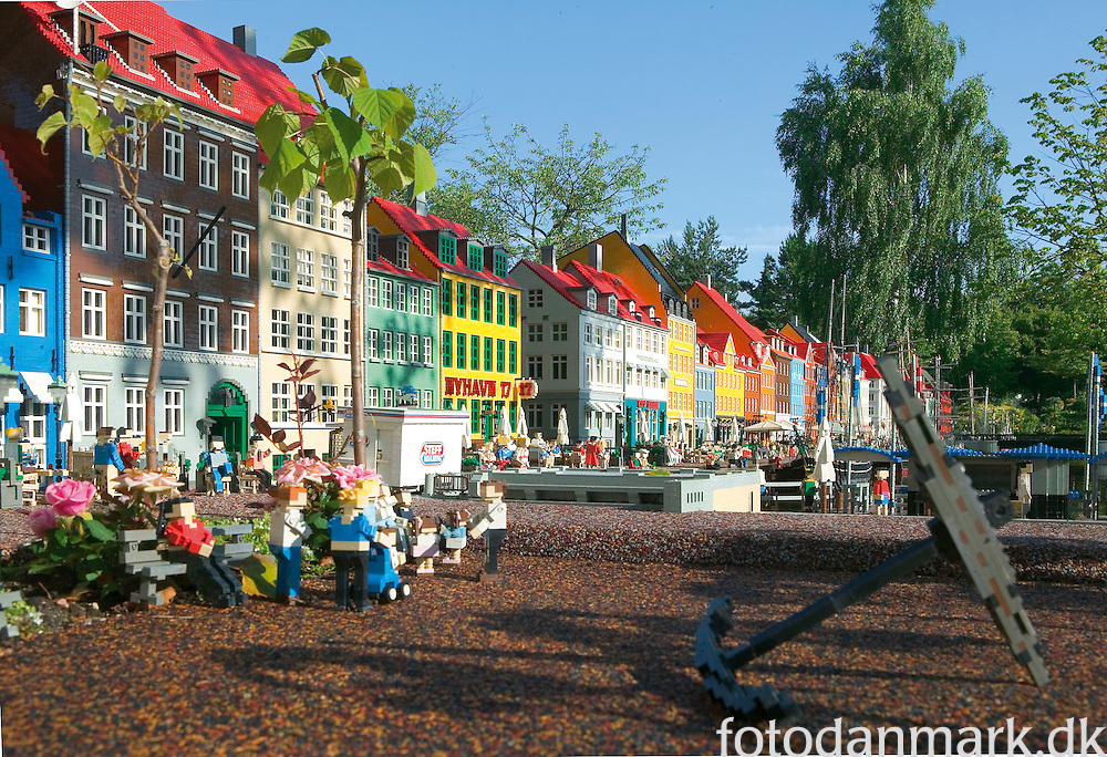 """Nyhavn (Danish pronunciation: [ˈnyhɑʊ̯n]) is a 17th century waterfront, canal and entertainment district in Copenhagen, Denmark. Stretching from Kongens Nytorv to the harbour front just south of the Royal Playhouse, it is lined by brightly coloured 17th and early 18th century townhouses and bars, cafes and restaurants. Serving as a """"heritage harbour"""", the canal has many historical wooden ships."""