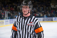 KELOWNA, CANADA - JANUARY 11:  Referee Brett Iverson skates off the ice as the Tri City Americans visit the Kelowna Rockets on January 11, 2013 at Prospera Place in Kelowna, British Columbia, Canada (Photo by Marissa Baecker/Shoot the Breeze) *** Local Caption ***
