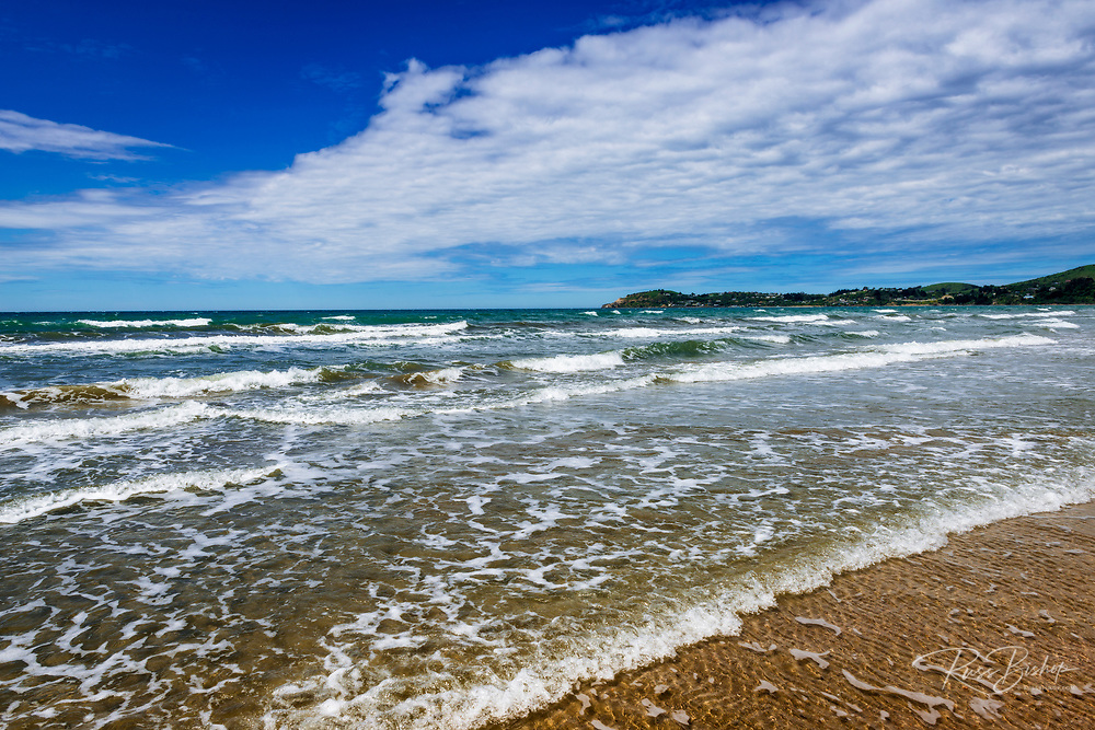 Surf and sand at Moeraki Beach, Moeraki, Otago, South Island, New Zealand