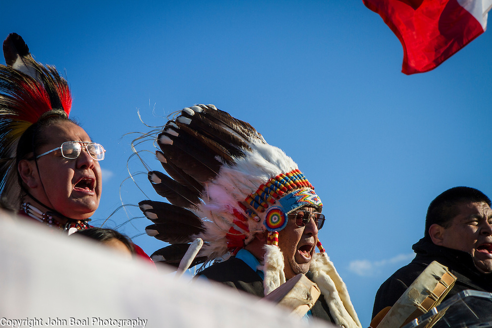 Dennis Zotigh, Kiowa, left, and his father, Ralph, sings and drums  during a protest and march from in front of the U.S. Capitol to the EPA, about the North Dakota Access Pipeline, as well as the effort to free Leonard Peltier.  Saturday, December 10, 2016. John Boal Photography
