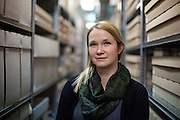 """Agnieszka Sieradzka, an employee working since almost 10 years for the collection department of the Auschwitz memorial in one of the archives with personal belongings of the prisoners which were taken away by the Nazis or found later at the camp. Mrs. Sieradzka said about her work """"We have to do our job professional and we have to keep an emotional distance to our work and this place.  I could not switch of these emotions in the beginning at all. I am working with the art of the prisoners what was a symbol of hope for them. I wanted to work here and to pass those informations further for future generations."""""""