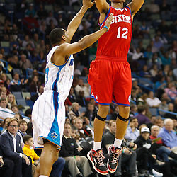 January 3, 2011; New Orleans, LA, USA; Philadelphia 76ers shooting guard Evan Turner (12) shoots over New Orleans Hornets shooting guard Willie Green (33) during the first quarter at the New Orleans Arena.   Mandatory Credit: Derick E. Hingle